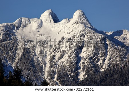 Vancouver Skyline Snowy Two Lions Snow Mountains British Columbia Pacific Northwest - stock photo