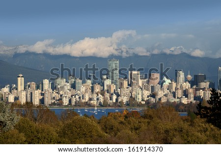 Vancouver - skyline with Coast Mountains and English Bay - stock photo