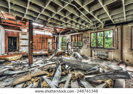 Vandalized office in an abandoned factory, HDR - stock photo