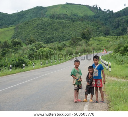 Vang Vieng August 8 : Unidentified street children posing on August 8 2016 , Vang vieng laos PDR