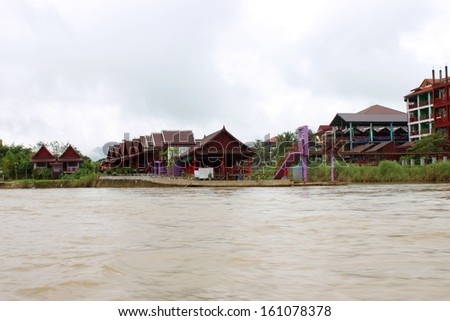 VANG VIENG, LAO P.D.R. - AUGUST 24 : Resorts and hotels are located on bank of Song River on August 24, 2013 in Vang Vieng, Lao P.D.R.