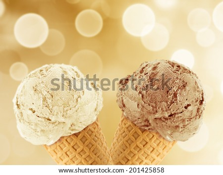 Vanilla and chocolate Ice cream in the cone with abstract light background. - stock photo