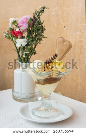 Vanilla and coffee ice cream in outdoor cafe in Rome - stock photo