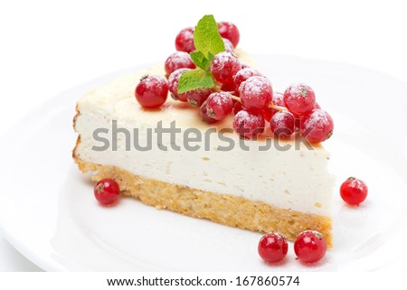 vanilla cheesecake with red currants on a plate, horizontal
