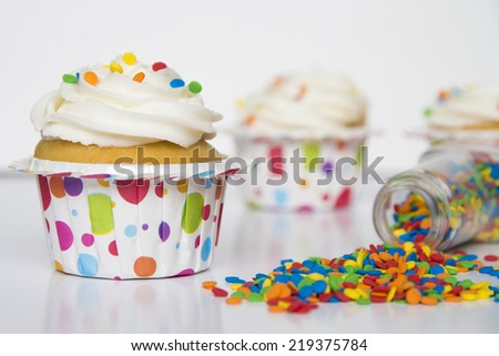 vanilla cupcake with confetti sprinkles - stock photo