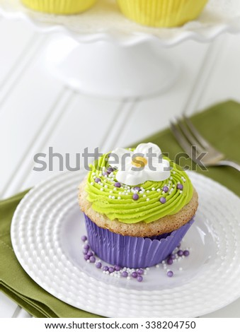 Vanilla cupcake with Dogwood flower - stock photo