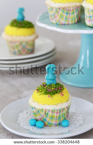 Vanilla cupcakes decorated with candy bunny for Easter - stock photo