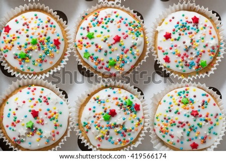 Vanilla cupcakes with white glaze, cupcake packaging, delivery box, top view,  selective focus, close up - stock photo