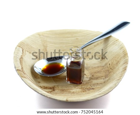 Vanilla Essence on the plate, white background