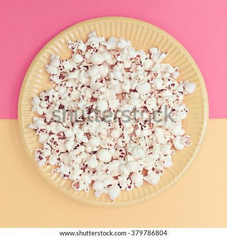 Vanilla fashion style. Popcorn in a plate. Minimalism art - stock photo