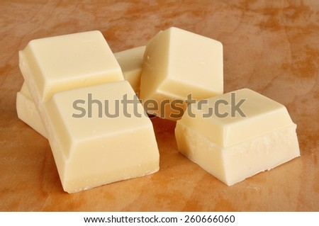 Vanilla Flavored Almond Bark (White Chocolate) on Cutting Board - stock photo