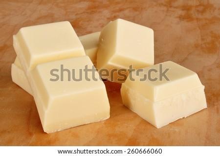 Vanilla Flavored Almond Bark (White Chocolate) on Cutting Board - stock photo