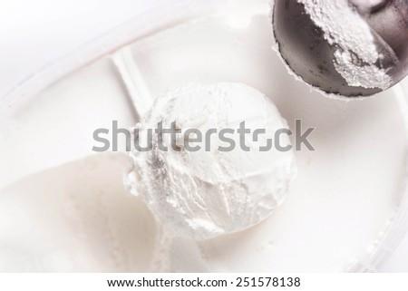 Vanilla ice cream scoop closeup. White  Ice Cream Background macro  - stock photo