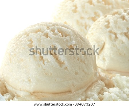 Vanilla ice cream scoops on white background