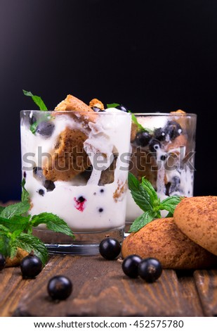 Vanilla ice cream with berries and mint in glasses