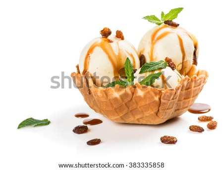 Vanilla ice cream with caramel sauce, raisins and mint in a wafer bowl isolated on white background - stock photo