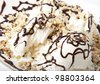 Vanilla ice cream with chocolate and nuts - stock photo