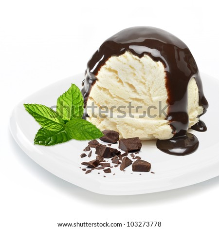Vanilla ice cream with chocolate sauce and mint in plate on white ...