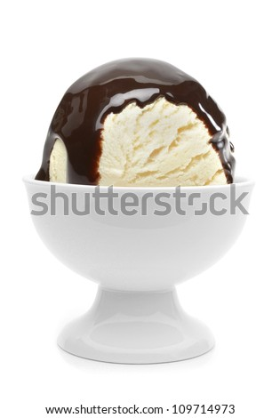 Vanilla ice cream with chocolate sauce in bowl on white background