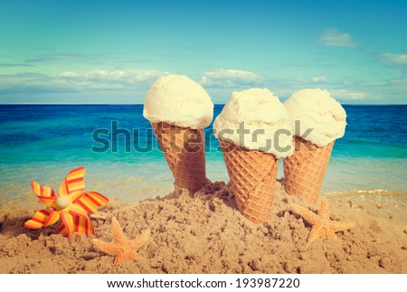 Vanilla ice creams on the beach - nostalgic retro tone effect added - stock photo