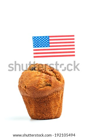 Vanilla muffin cake with american flag - 4th of july concept - isolated on white - stock photo