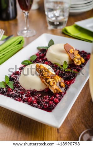 Vanilla panna cotta with forest fruit and caramel chips, restaurant shoot - stock photo