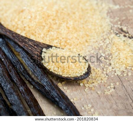 vanilla pods and brown cane sugar - stock photo