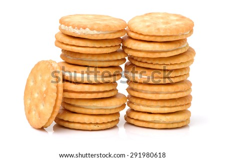 vanilla sandwich cookies on white background - stock photo