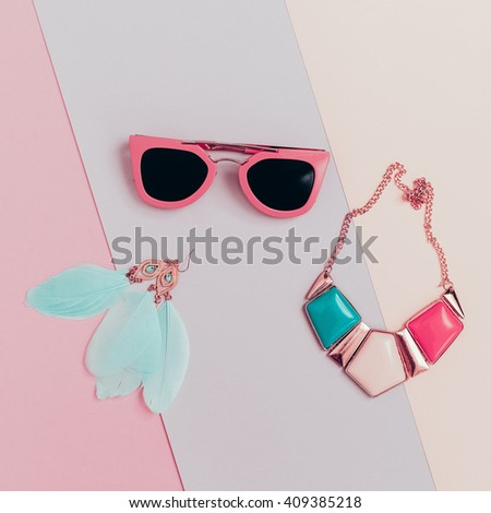 Vanilla Summer Trend. Fashionable. Women's Accessories. Necklace, Sunglasses and Earrings. Detail fashion - stock photo