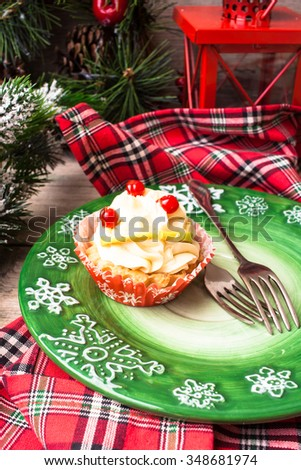 Vanilla tart on a christmas themed plate with utensils and checked napkin