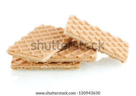 Vanilla wafers on white reflective background. - stock photo