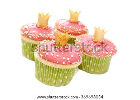 Vanilla wedding cupcakes with pink frosting decorated with pearls and a gold crown