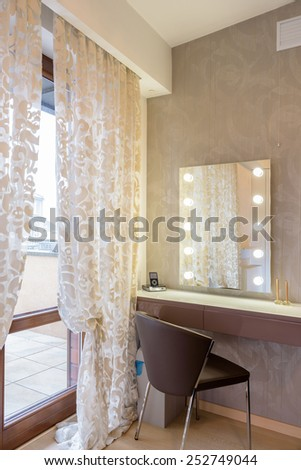 Vanity table for woman in modern bedroom in luxury apartment in Krakow city, Poland - stock photo