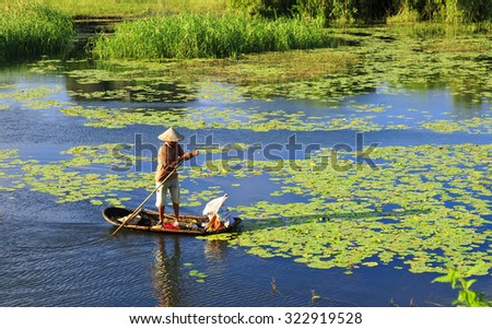 Vanlong, Ninhbinh, Vietnam - Sept 23, 2015: Life at nature reserve of VanLong wetlands - areas lagoon VanLong. Unidentified fisherman fishing reviews.