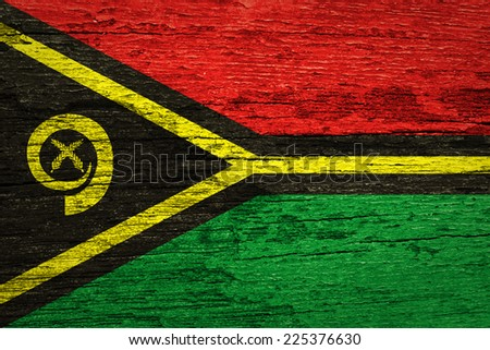 Vanuatu Flag painted on old wood background  - stock photo