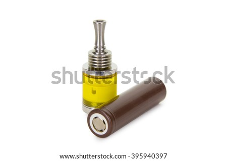 Vaping parts. Atomizer with brown battery. Isolated over white background.