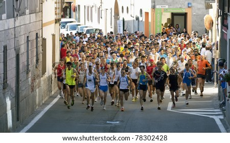 "VAPRIO D'AGOGNA, ITALY - MAY 29: An adult group of runners participate in the ""Marcia Nazionale Tricolore, Gamba d'Oro"" walking race on May 29, 2011 in Vaprio d'Agogna, Italy."