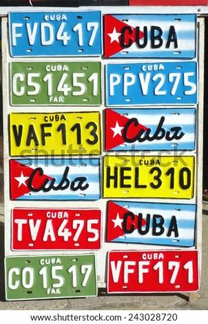 VARADERO, CUBA - DECEMBER 10, 2014: Vehicle plates on sale at a street stand in Varadero, Cuba. - stock photo