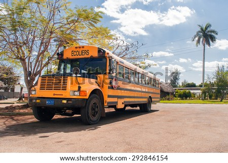 VARADERO, CUBA - February 5, 2008. Vintage classic school bus. Most of the Cubans drive cars that were on the road before 1959. - stock photo