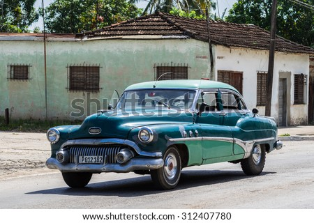 VARADERO, CUBA - JUNE 26, 2015: Propelled american classic car in the countryside