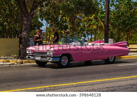 Varadero, Cuba - March 10, 2016: A vintage pink 1959 Cadillac Eldorado convertible car on Avendia 1ra in Varadero, Cuba - stock photo