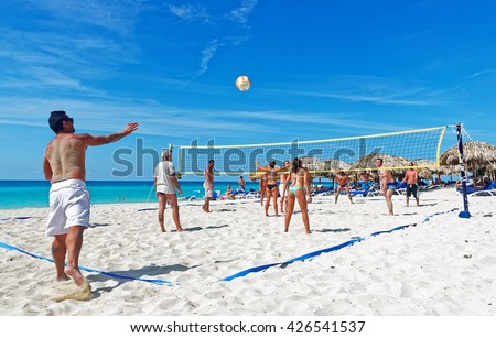 VARADERO, CUBA - May 13, 2016: Happy tourist playing beach volleyball. After more then five decades of restriction American tourist now can visit Cuba