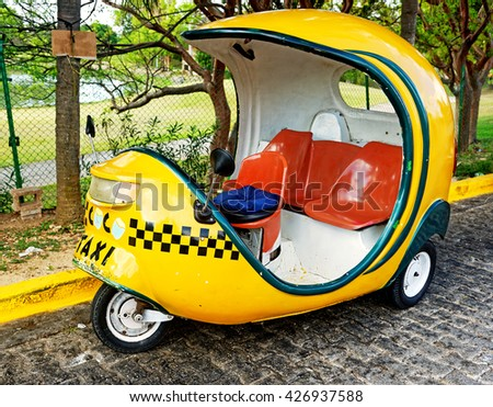 VARADERO, CUBA - May 13, 2016: The coconut tricycle taxi is a tourist and locals most affordable transportation in Cuba. - stock photo