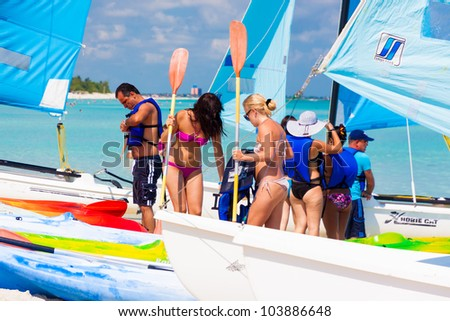 VARADERO,CUBA-MAY 27:Tourists getting ready to go sailing May 27,2012 in Varadero.With over a million visitors per year,Varadero is the main destination for the growing cuban tourism industry - stock photo