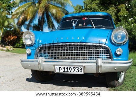 VARADERO, CUBA - NOVEMBER 3, 2015: Bright blue retro automobile on town streets