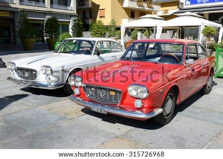Varallo, Italy - 6 September 2015: People during an exhibition of vintage cars at Varallo Sesia village, Piedmont, Italy