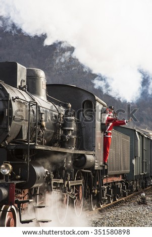 VARALLO SESIA, PIEDMONT, ITALY - 2015, DECEMBER 13:  steam train with Santa Claus arrives at the station