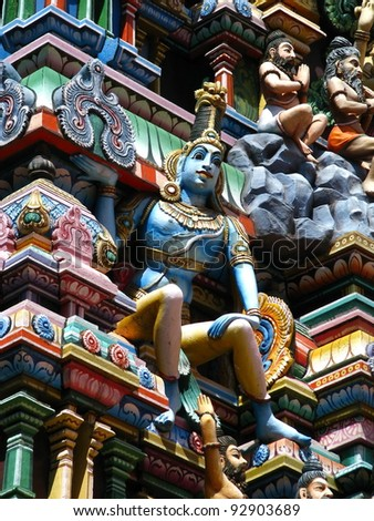 Varanasi (Benares), India: polychromed figures of hinduist gods on the roof of a temple. - stock photo