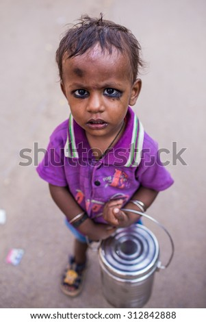 VARANASI, INDIA - AUGUST 2, 2015: Unidentified beggar child on the street in Varanasi. Poverty is a major issue in India. - stock photo
