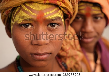 VARANASI - INDIA - DECEMBER 18, 2015: Unidentified young sadhu on the ghats of Ganges on December 18, 2015 in Varanasi, India. Varanasi is the holiest of the seven sacred cities in India. - stock photo